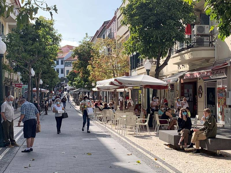 2FNP2FF People in Funchal, Madeira. Expat business owners in Madeira believe the return of British holidaymakers will help ???rejuvenate??? an island hit by a lack of tourism during the coronavirus pandemic. Picture date: Tuesday May 18, 2021.
