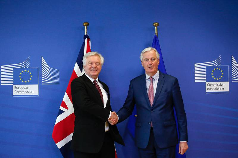 David Davis, U.K. exiting the European Union (EU) secretary, left, and Michel Barnier, chief negotiator for the European Union (EU), pose for a photograph ahead of Brexit negotiations in Brussels, Belgium, on Monday, March 19, 2018. As Brexit talks enter a crucial phase this week, pound traders are cautiously waiting for signs of progress toward a transition deal. Even if those expectations are met, any gains in the currency may be short-lived. Photographer: Dario Pignatelli/Bloomberg
