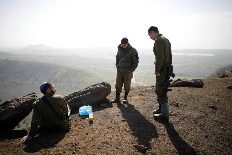 Israeli soldiers stand in an open area near Mount Bental, an observation post in the Israeli-occupied Golan Heights that overlooks the Syrian side of the Quneitra crossing, Israel January 21, 2019. REUTERS/Amir Cohen