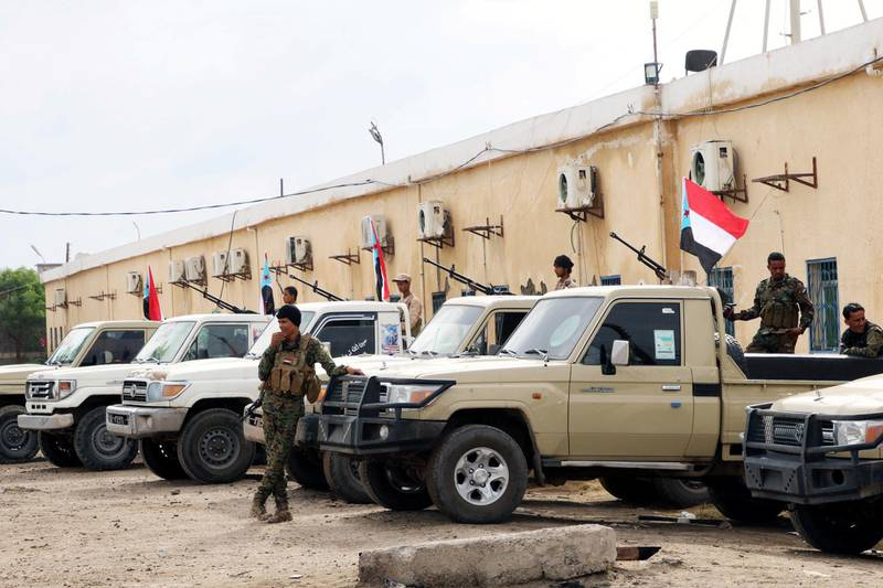 FILE PHOTO: Security forces loyal to the separatist Southern Transitional Council stand next to vehicles as they are deployed in the southern port city of Aden, Yemen December 20, 2020. REUTERS/Fawaz Salman/File Photo