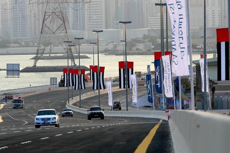 October 14, 2009 -- Abu Dhabi -- Sheikh Khalifa Bridge opened Wednesday, Oct 14th, 2009, allowing cars a new route off and on the island of Abu Dhabi, connecting Abu Dhabi and Saadiyat Islands and opening the Shahama-Saadiyat Highway.  (Rich-Joseph Facun / The National)  *** Local Caption ***  rjf-1014-saadiyatbridge007.jpg