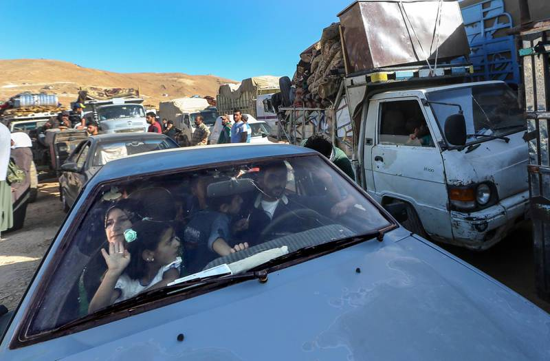 epa06906535 Syrian refugees sit inside their cars waiting to be evacuated from their refugee camps in the village of Arsal, east of Lebanon, 23 July 2018, to return home to their villages in al-Qalamoun area in the western Damascus countryside. According to media reports, Lebanon hosts 1,011,366 Syrian refugees registered with UNHCR, Including 80 thousand refugees living in seven camps in the city of Arsal. 850 person who have permission from the Syrian authority left to return home on 23 July 2018, where tousends of Syrian refugees families registers their names and wait the syrian permission.  EPA/NABIL MOUNZER