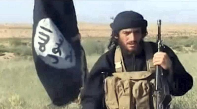 """An image grab taken from a video uploaded on YouTube on July 8, 2012, shows the spokesman for the Islamic State of Iraq and the Levant (ISIL), Abu Mohammad al-Adnani al-Shami, speaking next to an Al-Qaeda-affiliated flag at an undisclosed location. AFP PHOTO / YOUTUBE == RESTRICTED TO EDITORIAL USE - MANDATORY CREDIT """"AFP PHOTO / YOUTUBE """" - NO MARKETING NO ADVERTISING CAMPAIGNS - DISTRIBUTED AS A SERVICE TO CLIENTS FROM FROM ALTERNATIVE SOURCES, THEREFORE AFP IS NOT RESPONSIBLE FOR ANY DIGITAL ALTERATIONS TO THE PICTURE'S EDITORIAL CONTENT, DATE AND LOCATION WHICH CANNOT BE INDEPENDENTLY VERIFIED (Photo by - / YouTube / AFP) / AFP PHOTO / YOUTUBE == RESTRICTED TO EDITORIAL USE - MANDATORY CREDIT """"AFP PHOTO / YOUTUBE """" - NO MARKETING NO ADVERTISING CAMPAIGNS - DISTRIBUTED AS A SERVICE TO CLIENTS FROM FROM ALTERNATIVE SOURCES, THEREFORE AFP IS NOT RESPONSIBLE FOR ANY DIGITAL ALTER"""