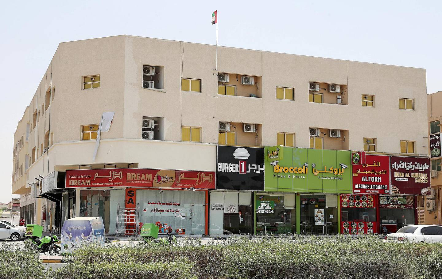 AJMAN , UNITED ARAB EMIRATES , JULY 26 – 2018 :- View of the shops on Sheikh Ammar street in Al Muwaihat area in Ajman.  ( Pawan Singh / The National )  For News. Story by Salam Al Amir