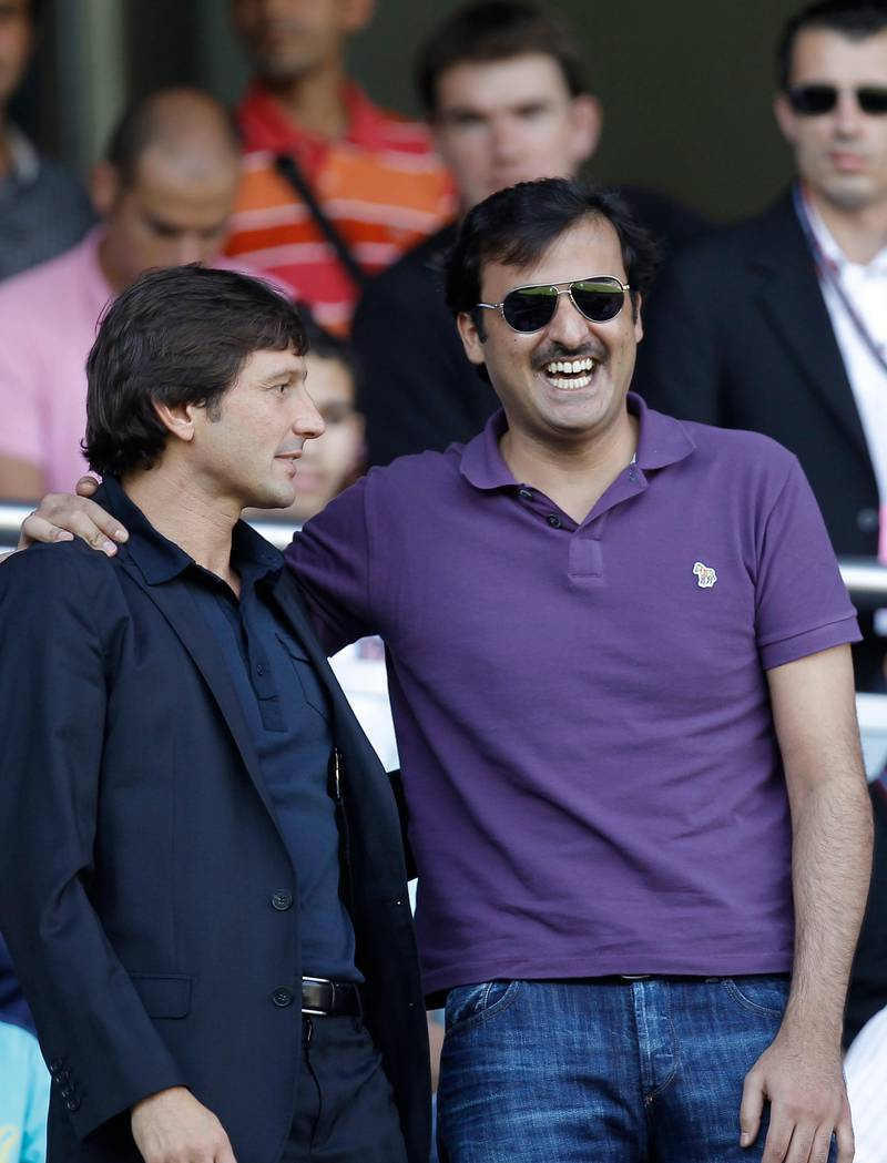 Brazilian's PSG manager Leonardo, left, is seen  with new club owner, Qatar's Crown Prince Sheikh Tamim Bin Hamad Al Thani prior to  the French League one soccer match at the Parc des Princes, in Paris, Sunday, Aug. 21, 2011. (AP Photo/Jacques Brinon) *** Local Caption ***  France Soccer.JPEG-047a0.jpg
