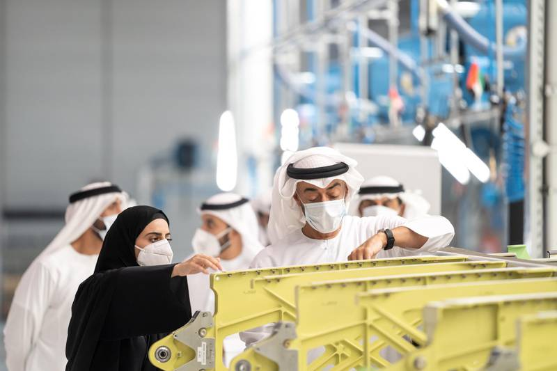 AL AIN, ABU DHABI, UNITED ARAB EMIRATES - June 24, 2020: HH Sheikh Mohamed bin Zayed Al Nahyan, Crown Prince of Abu Dhabi and Deputy Supreme Commander of the UAE Armed Forces (R) visits Strata Manufacturing PJSC, at Al Ain International airport.  ( Abdullah Al Junaibi for the Ministry of Presidential Affairs ) ---
