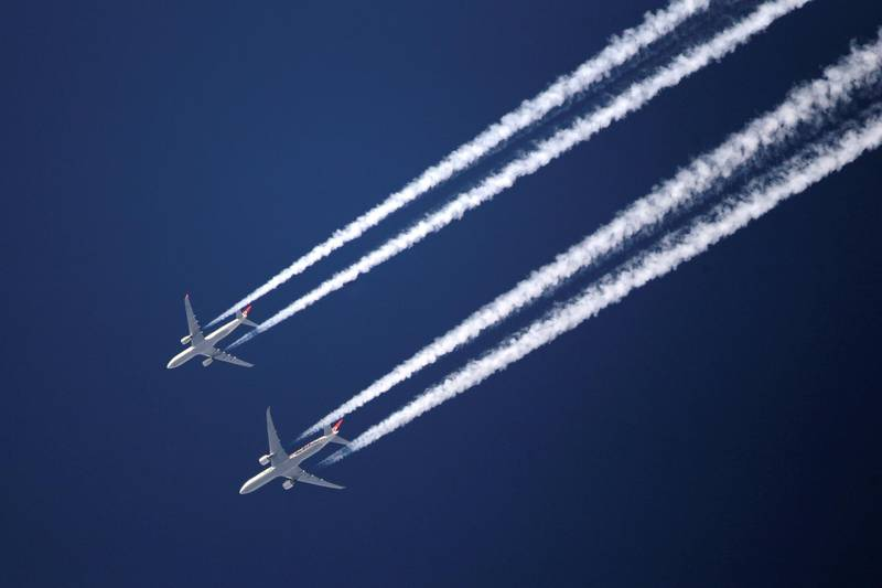 LONDON, ENGLAND - MARCH 12:  Two commercial airliners appear to fly close together as the pass over London on March 12, 2012 in London, England.  (Photo by Dan Kitwood/Getty Images)
