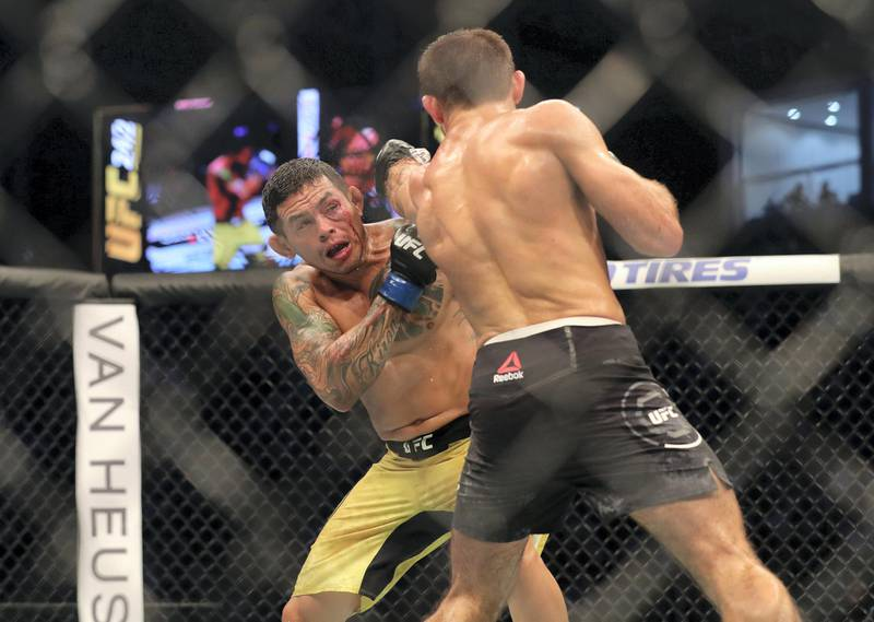 Abu Dhabi, United Arab Emirates - September 07, 2019: Lightweight bout between Mairbek Taisumov and Diego Ferreira (yellow shorts, winner) in the Main card at UFC 242. Saturday the 7th of September 2019. Yas Island, Abu Dhabi. Chris Whiteoak / The National