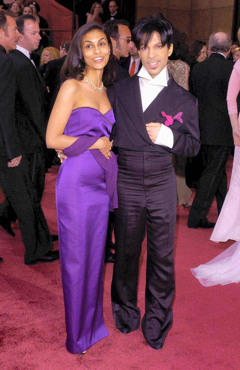 Prince and guest (Photo by Lester Cohen/WireImage)