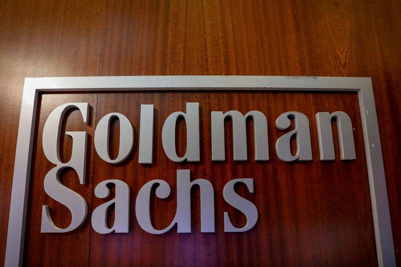 FILE PHOTO: The Goldman Sachs company logo is seen in the company's space on the floor of the New York Stock Exchange, (NYSE) in New York, U.S., April 17, 2018. REUTERS/Brendan McDermid/File Photo