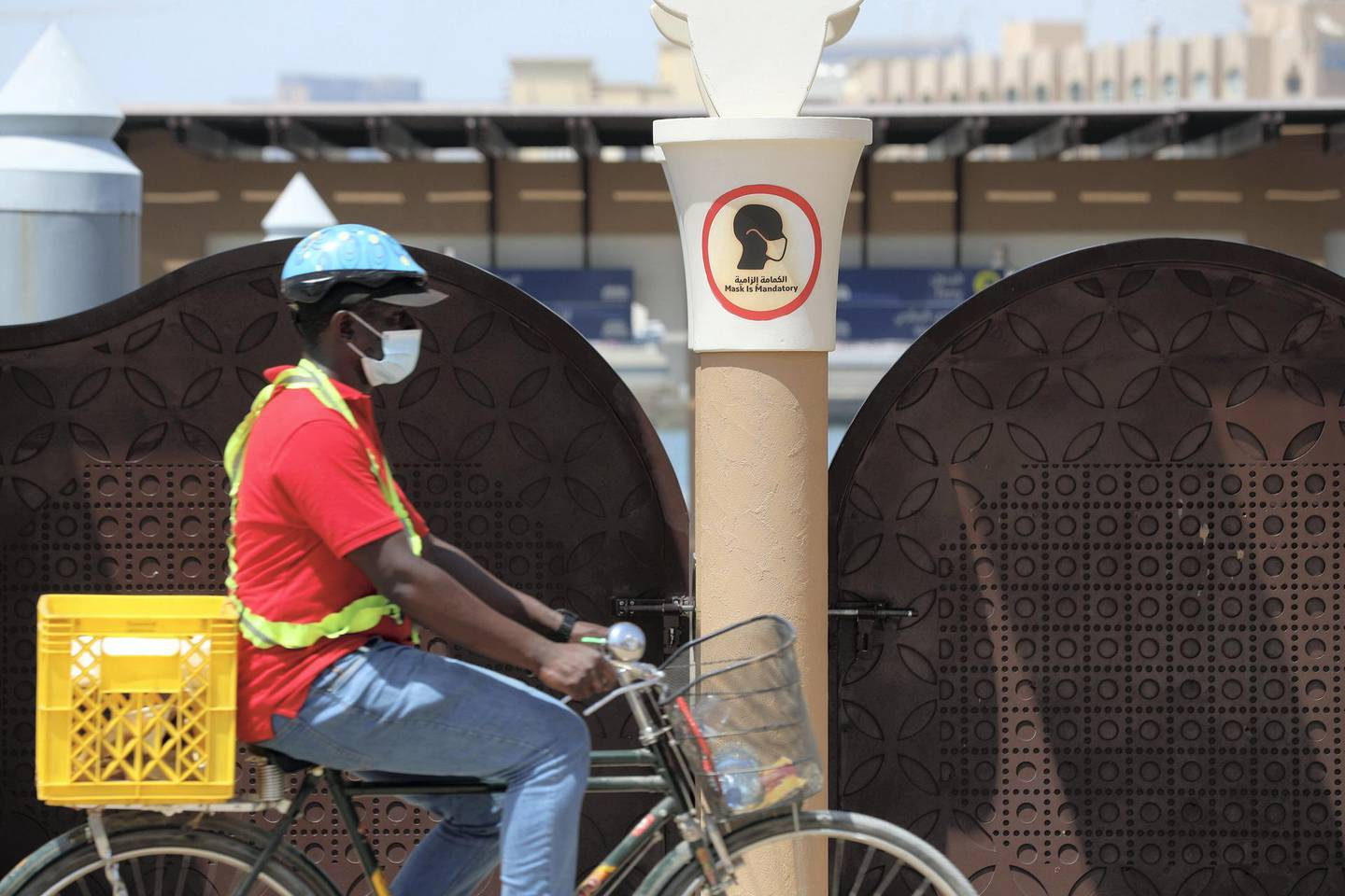 A man on a bike wears a mask to protect him from Covid-19 in Bur Dubai on June 1st, 2021. Chris Whiteoak / The National.  Reporter: N/A for News