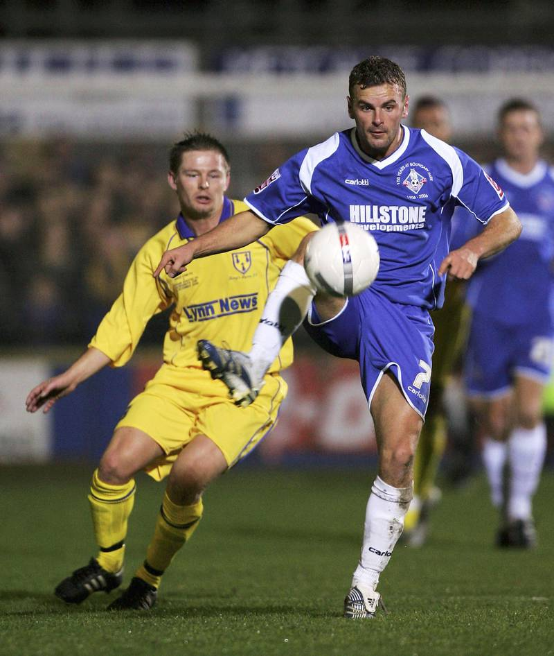 KINGS LYNN, UNITED KINGDOM - DECEMBER 1: Richie Wellens of Oldham wins the ball ahead of Grant Cooper of Kings Lynn during the FA Cup Second Round match between Kings Lynn and Oldham Athletic at The Walks Stadium on December 1, 2006 in Kings Lynn, England. (Photo by Matthew Lewis/Getty Images)