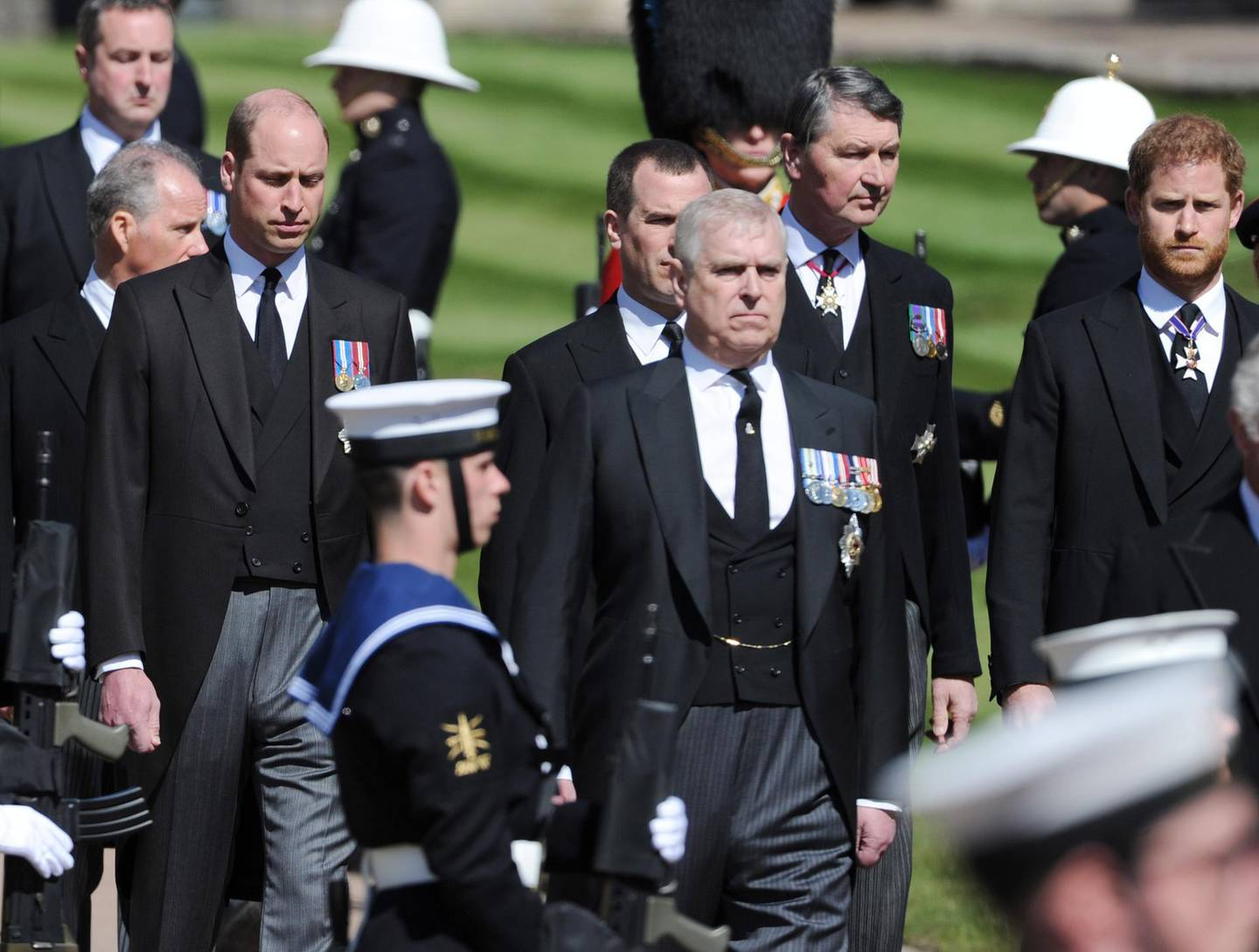 WINDSOR, ENGLAND - APRIL 17:  Prince Andrew, Duke of York; Prince Harry, Duke of Sussex; Prince William, Duke of Cambridge and Vice-Admiral Sir Timothy Laurence walk behind The Duke of Edinburgh's coffin, covered with His Royal Highness's Personal Standard, during the Ceremonial Procession during the funeral of Prince Philip, Duke of Edinburgh at Windsor Castle on April 17, 2021 in Windsor, England. Prince Philip of Greece and Denmark was born 10 June 1921, in Greece. He served in the British Royal Navy and fought in WWII. He married the then Princess Elizabeth on 20 November 1947 and was created Duke of Edinburgh, Earl of Merioneth, and Baron Greenwich by King VI. He served as Prince Consort to Queen Elizabeth II until his death on April 9 2021, months short of his 100th birthday. His funeral takes place today at Windsor Castle with only 30 guests invited due to Coronavirus pandemic restrictions. (Photo by Mark Large-WPA Pool/Getty Images)