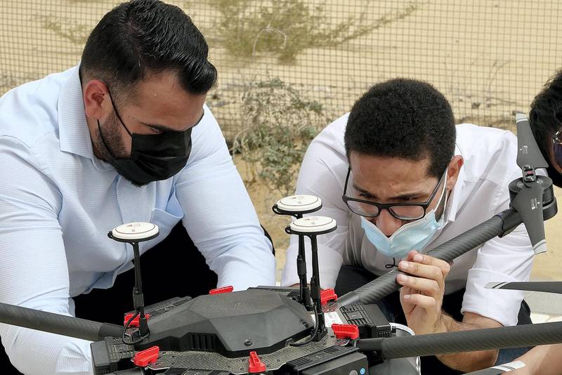 DUBAI, UNITED ARAB EMIRATES , March 16, 2021 – Ahmed Borik - IoT Systems Engineer (right) with the Cafu drone during the press conference at the Sanad Academy, Skyhub RC Club in Dubai. Cafu is using drones to plant 1 million Ghaf seeds in the UAE. (Pawan Singh / The National) For News/Online/Instagram/Big Picture. Story by Patrick