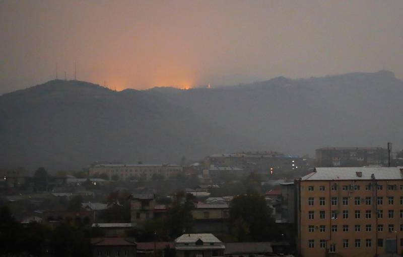 Bursts of explosions are seen in Shushi outside Stepanakert, the separatist region of Nagorno-Karabakh, early Wednesday, Nov. 4, 2020. Fighting over the separatist territory of Nagorno-Karabakh entered sixth week on Sunday, with Armenian and Azerbaijani forces blaming each other for new attacks. (AP Photo)