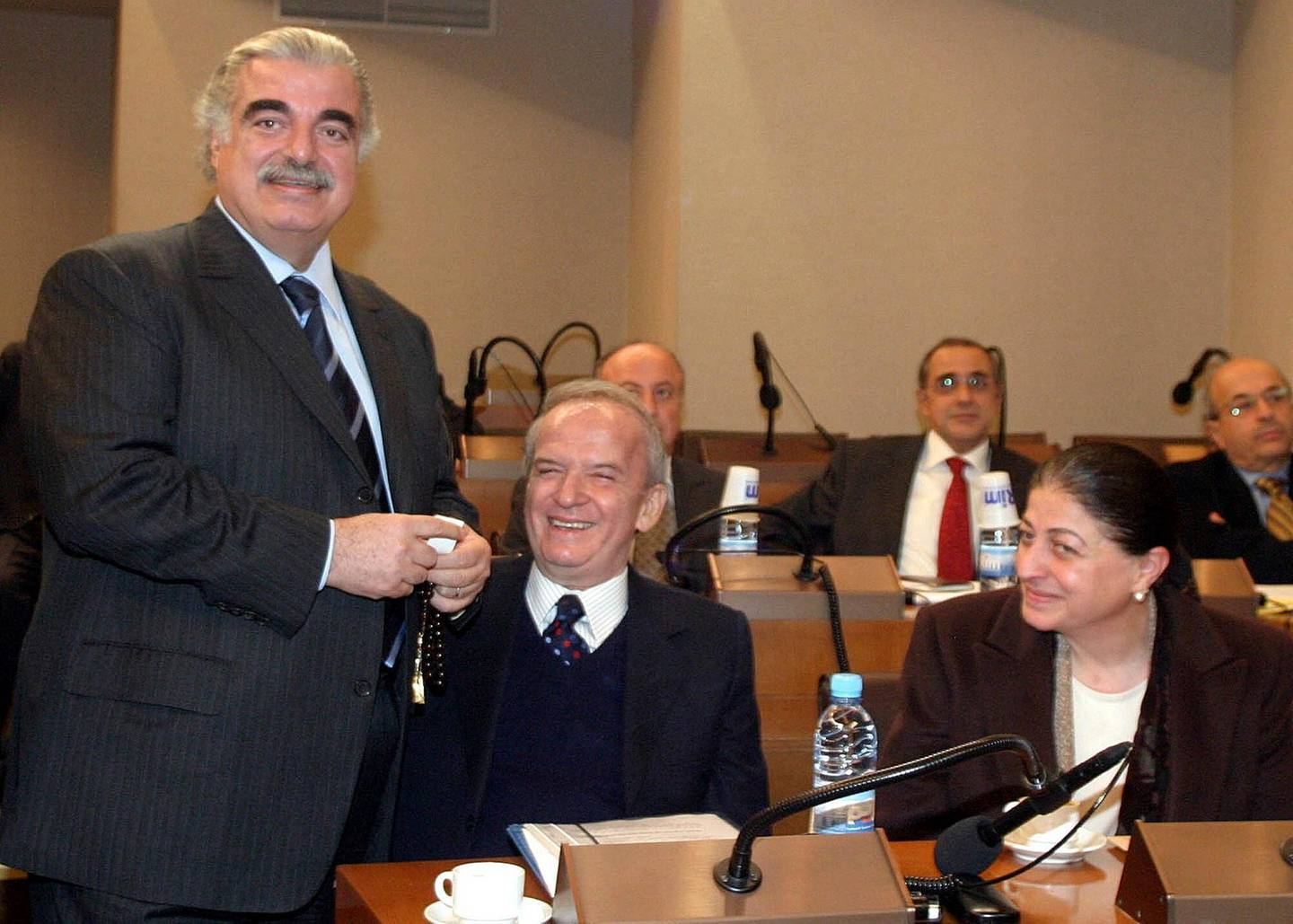 FILE - In this Feb. 14, 2005 file photo former Lebanese Prime Minister Rafik Hariri, left, Parliament member Marwan Hamadeh and Bahiyah Hariri, sister of President Hariri, are pictured during a meeting at the Parliament in Beirut. More than 15 years after the truck bomb assassination of former Lebanese Prime Minister Rafik Hariri in Beirut, a U.N.-backed tribunal in the Netherlands is announcing verdicts this in the trial of four members of the militant group Hezbollah allegedly involved in the killing, which deeply divided the tiny country. (AP Photo, File)