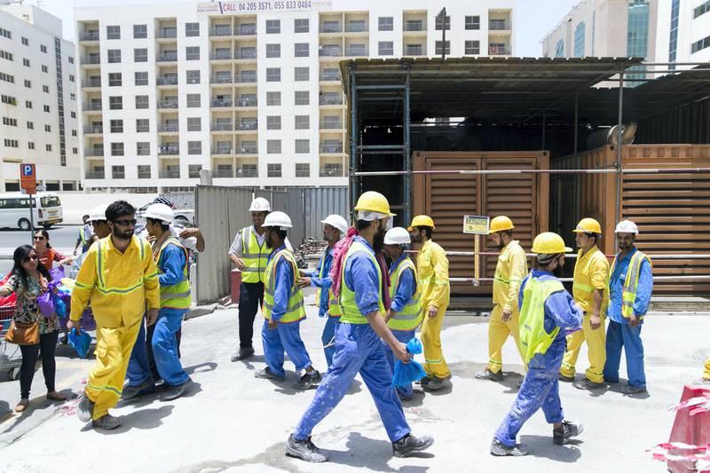 DUBAI, UNITED ARAB EMIRATES - MAY 28, 2018. The Ramadan Sharing Fridges initiative in Dubai, distributes meals to construction workers in Bur Dubai.(Photo by Reem Mohammed/The National)Reporter: Nawal Al RamahiSection: NA