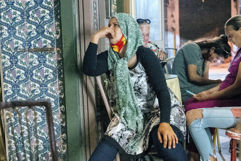 Lamia comes to watch every match in her favorite cafe, an old tiled den snuggled between two stalls selling shoes and ladies underwear just inside the medina gates. Erin Clare Brown/ The National