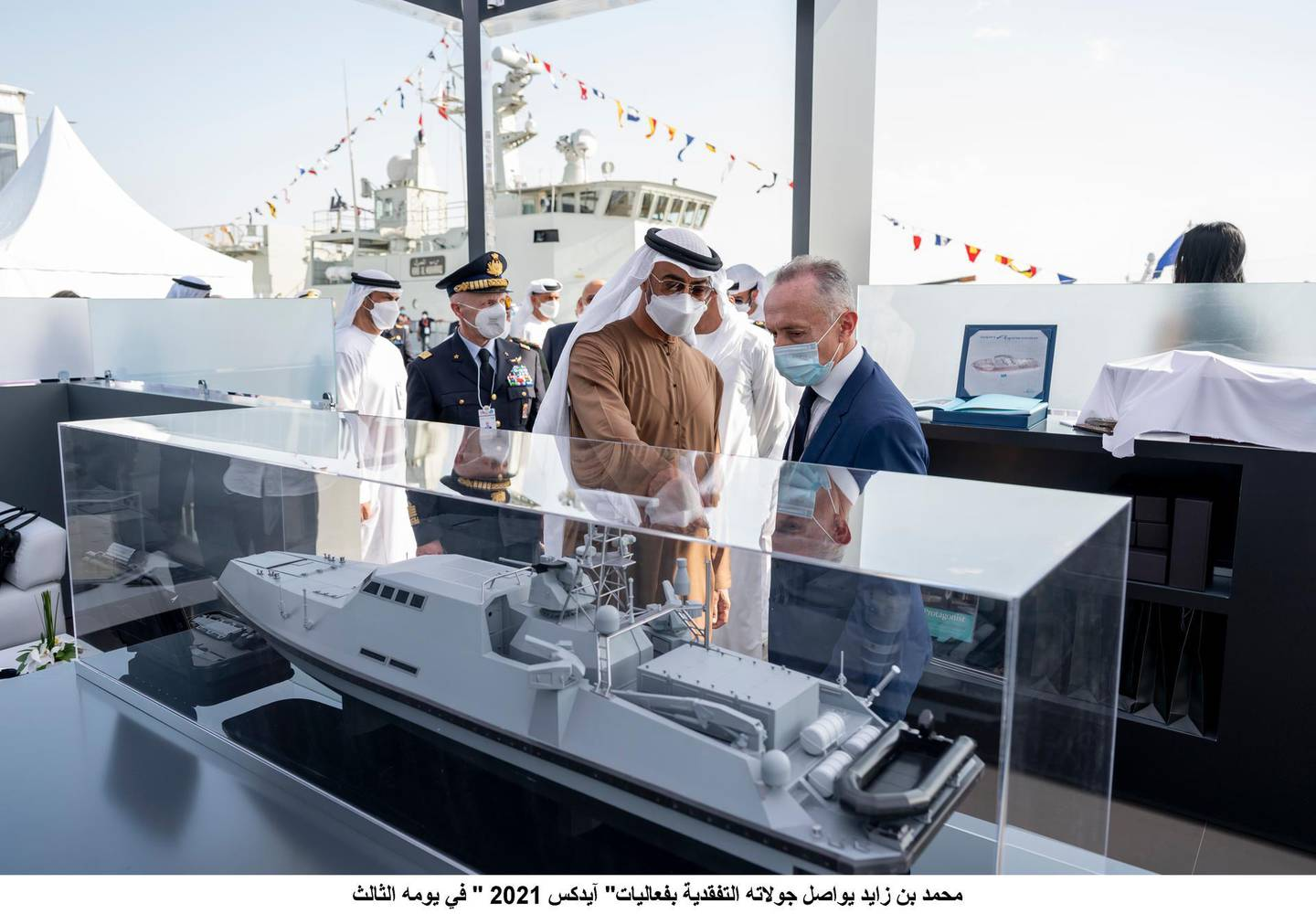 ABU DHABI, UNITED ARAB EMIRATES - February 23, 2021: HH Sheikh Mohamed bin Zayed Al Nahyan, Crown Prince of Abu Dhabi and Deputy Supreme Commander of the UAE Armed Forces (2nd R), tours the 2021 Naval Defence and Maritime Security Exhibition (NAVDEX), at ADNEC. ( Hamad Al Kaabi / Ministry of Presidential Affairs )---