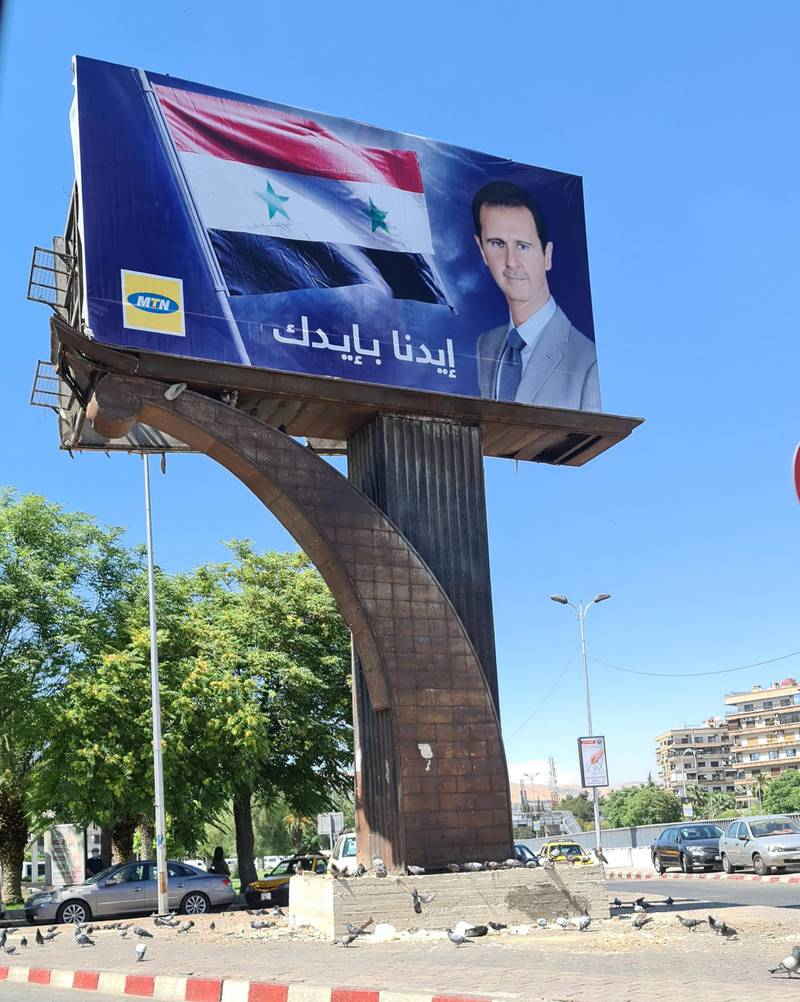 """Another Syrian telecommunications provider MTN says """"Our hand with yours"""" with Assad's picture"""