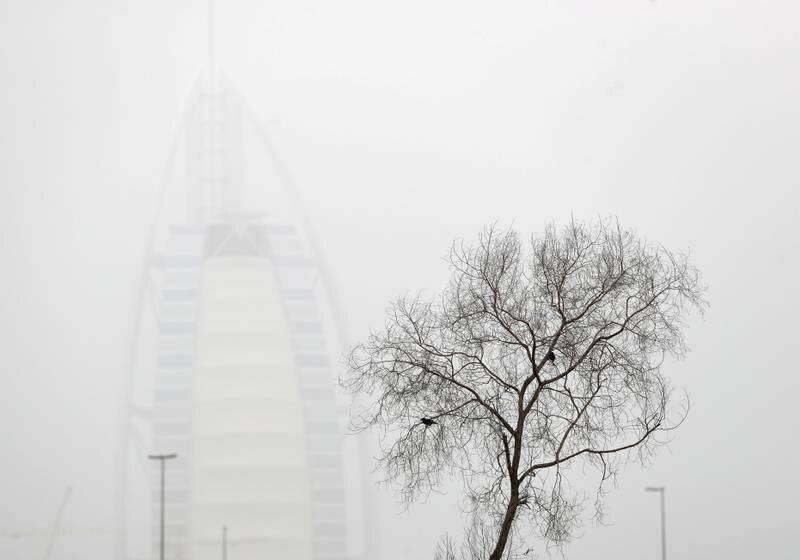 Dubai, United Arab Emirates - Reporter: N/A: Weather. The Burj Al Arab on a dusty and hazy day in Dubai. Sunday, March 29th, 2020. Dubai. Chris Whiteoak / The National