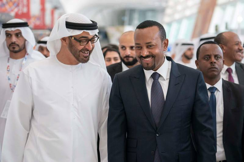 ABU DHABI, UNITED ARAB EMIRATES - March 18, 2019: HH Sheikh Mohamed bin Zayed Al Nahyan, Crown Prince of Abu Dhabi and Deputy Supreme Commander of the UAE Armed Forces (L) and HE Abiy Ahmed, Prime Minister of Ethiopia (R), tour the Special Olympics World Games Abu Dhabi 2019, at Abu Dhabi National Exhibition Centre (ADNEC).  ( Ryan Carter / Ministry of Presidential Affairs )? ---