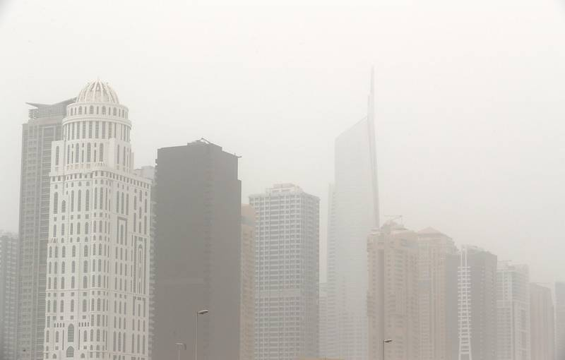 DUBAI , UNITED ARAB EMIRATES , JULY 30 – 2018 :- View of the residential and office towers during the dusty and hot weather in Jumeirah Lake Towers in Dubai. ( Pawan Singh / The National )  For News.