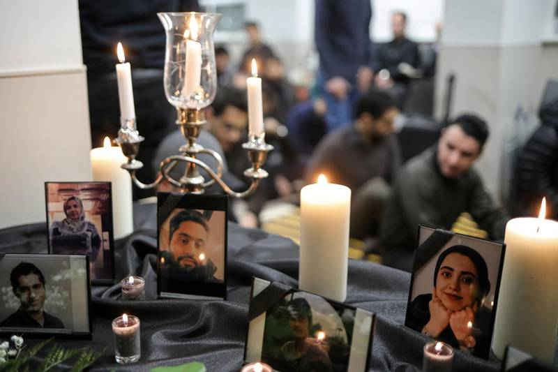 FILE PHOTO: Photographs of student victims of a Ukrainian passenger jet which crashed in Iran are seen during a vigil at University of Toronto student housing in Toronto, Ontario, Canada January 8, 2020.  REUTERS/Chris Helgren/File Photo