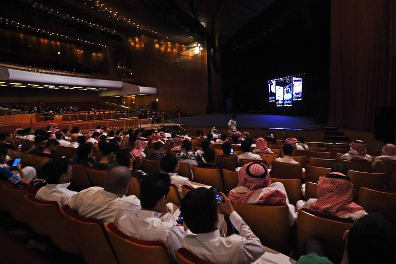 """(FILES) This file photo taken on October 20, 2017 shows Saudis attending the """"Short Film Competition 2"""" festival at King Fahad Culture Center in Riyadh. Saudi Arabia on December 11, 2017 lifted a decades-long ban on cinemas, part of a series of social reforms by the powerful crown prince that are shaking up the ultra-conservative kingdom. / AFP PHOTO / FAYEZ NURELDINE"""