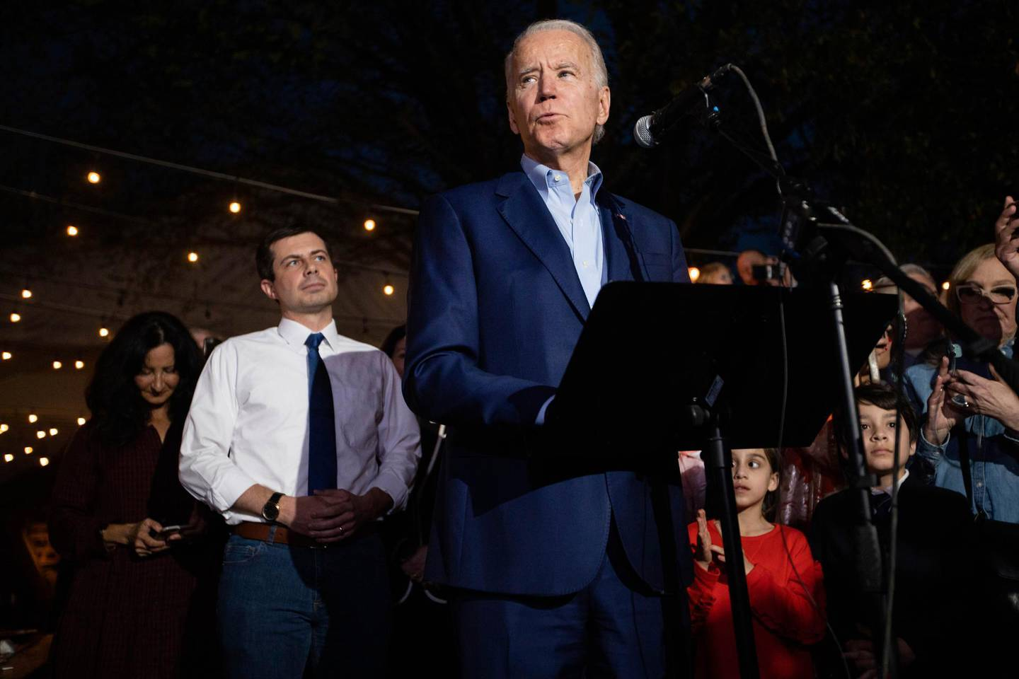 Democratic presidential primary candidate, former Vice President Joe Biden speaks during an event at the Chicken Scratch restaurant the night before Super Tuesday primary voting, on Monday night March 2, 2020 in Dallas. Former Democratic presidential primary candidate Pete Buttigieg, center left, was there to endorse Biden after he stopped his campaign Sunday. (Juan Figueroa/The Dallas Morning News via AP)