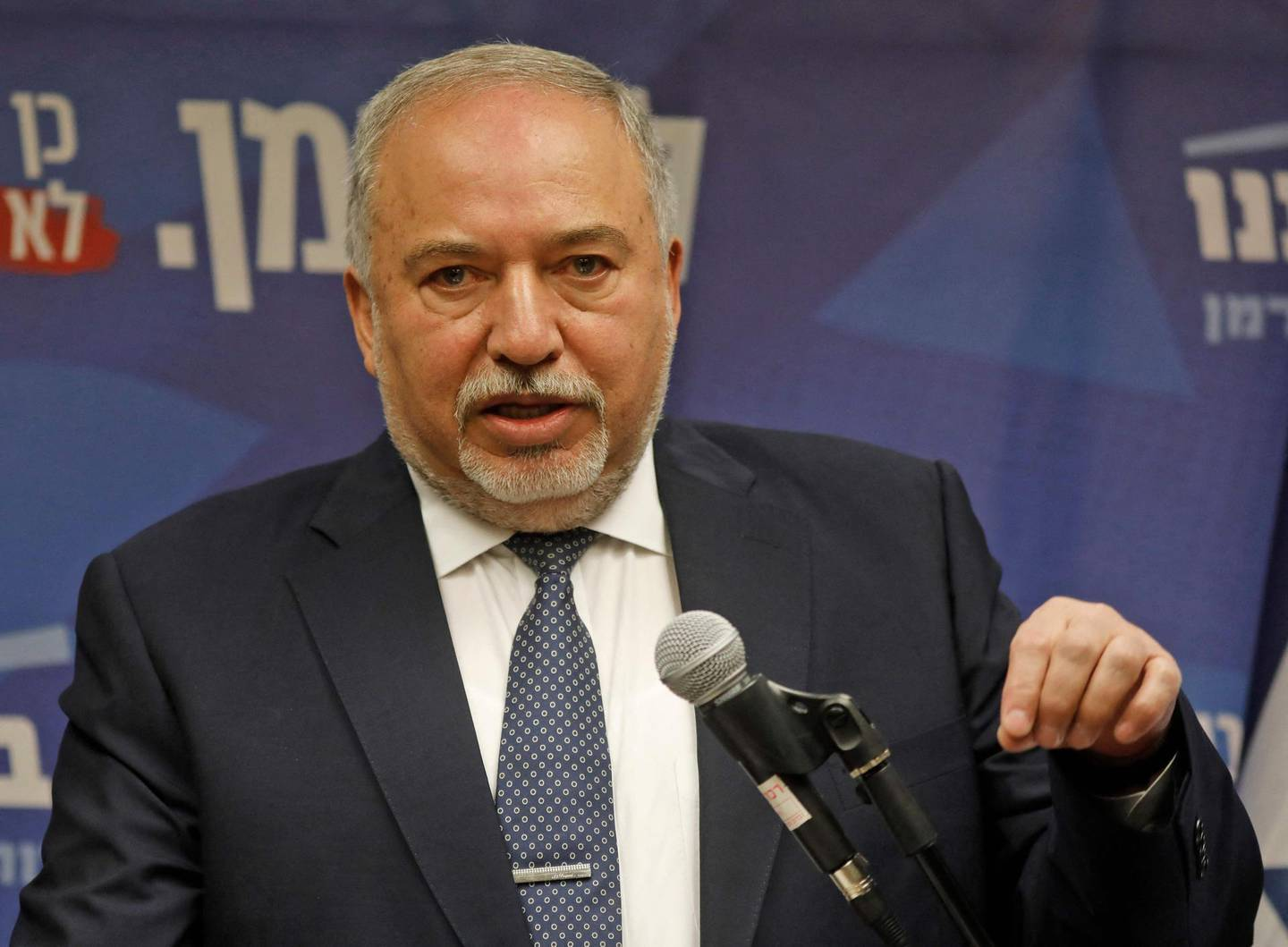 (FILES) In this file photo taken on November 20, 2019 Yisrael Beitenu's party head Avigdor Lieberman delivers a statement to the press on November 20, 2019 in Jerusalem as the deadline for Iserael's opposition to form Israeli government ends. A coalition government or new elections? Israeli Prime Minister Benjamin Netanyahu and rival Benny Gantz traded blame over faltering talks Wednesday ahead of a midnight deadline. Former military general Gantz has until 11:59 pm (2159 GMT) to cut a coalition deal, or the country will edge closer to holding a third round of elections in a year.  / AFP / MENAHEM KAHANA