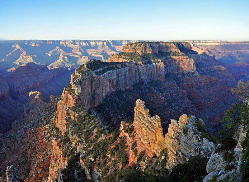 Cape Royal on the North Rim provides a panorama up, down, and across the canyon. With seemingly unlimited vistas to the east and west, it is popular for both sunrise and sunset. The sweeping turn of the Colorado River at Unkar Delta is framed through the natural arch of Angels Window. Look for the Desert View Watchtower across the canyon on the South Rim. This popular viewpoint is accessible via a paved, level trail. Cape Royal and Point Imperial are reached via a winding scenic drive. The trip to both points, with short walks at each and several stops at pullouts along the way, can easily take half a day. Lodging and food service facilities on the North Rim of Grand Canyon National Park are open for the summer season between May 15 and October 15 of each year. Grand Canyon Lodge North Rim, a Forever Resorts property, and Grand Canyon Trail Rides operate during this 5 month period. For more information visit: http://www.nps.gov/grca/planyourvisit/directions_n_rim.htmNPS Photo by Michael Quinn
