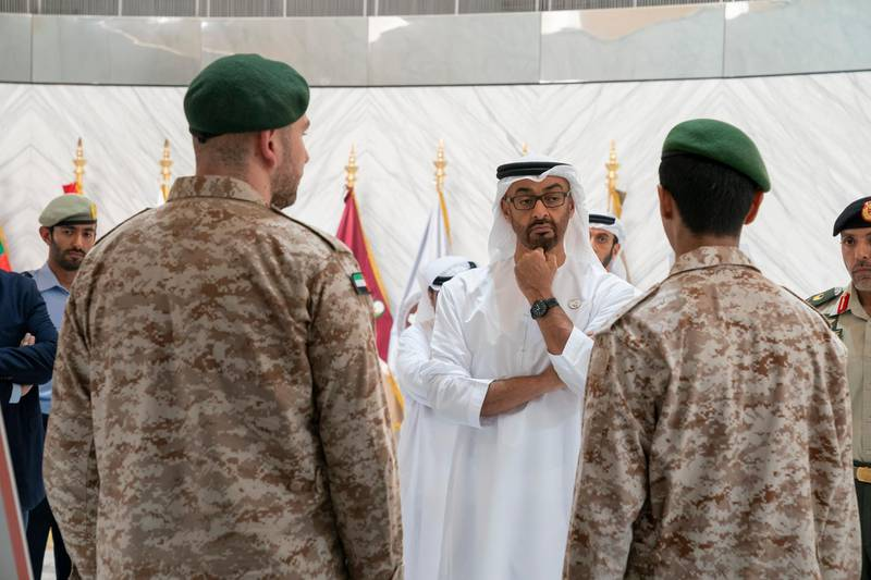 ABU DHABI, UNITED ARAB EMIRATES - April 28, 2019: HH Sheikh Mohamed bin Zayed Al Nahyan, Crown Prince of Abu Dhabi and Deputy Supreme Commander of the UAE Armed Forces (C), attends e-skills exhibition for national service recruits, at Armed Forces Officers Club. ( Mohamed Al Hammadi / Ministry of Presidential Affairs ) ---