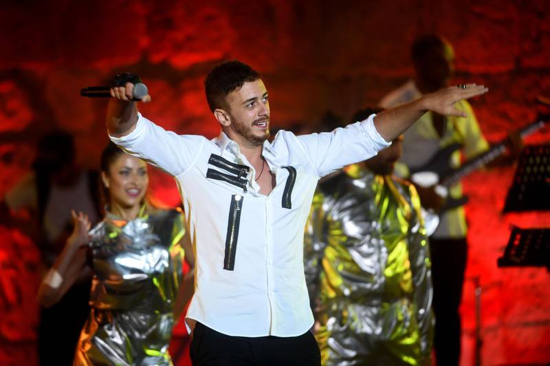 (FILES) In this file photograph taken on July 30,2016, Moroccan singer Saad Lamjarred performs during the 52nd session of the International Carthage Festival at The Roman Theatre of Carthage near Tunis. A social media campaign has been launched to ban the songs of Moroccan pop star Saad Lamjarred on the country's radio stations after he was charged in France in a third case involving rape charges. / AFP / FETHI BELAID