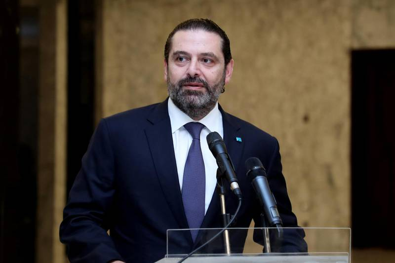 """A handout picture provided by the Lebanese photo agency Dalati and Nohra on November 7, 2019 shows caretaker prime minister Saad Hariri addressing the press after his meeting with the president at Baabda presidential palace, east of the capital Beirut. - Hariri met President Michel Aoun and said that consultations were ongoing with all political players but gave no details. (Photo by - / DALATI AND NOHRA / AFP) / === RESTRICTED TO EDITORIAL USE - MANDATORY CREDIT """"AFP PHOTO / HO / DALATI AND NOHRA"""" - NO MARKETING - NO ADVERTISING CAMPAIGNS - DISTRIBUTED AS A SERVICE TO CLIENTS ==="""
