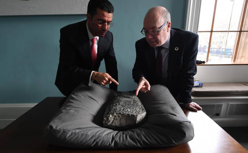 epa07447943 His Excellency Dr Salih Husain Ali (L) with British Minister of the Middle East and North Africa Alistair Burt with an Iraqi 'kudurru' (boundary stone) at the British Museum in London, Britain, 19 March 2019. The kudurru is set to be returned to Iraq from the British Museum. The stone was seized at Heathrow Airport by UK Border Force in 2012. Many archaeological sites in southern Iraq were looted between 1994 and 2004.  EPA/ANDY RAIN