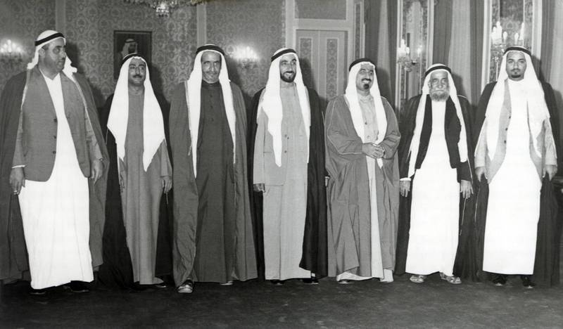 The Rulers of the 7 Emirates, Sheikh Zayed Bin Sultan Al Nahyan, Sheikh Rashid Bin Saeed Al Maktoum, Sheikh Sultan Bin Mohammed Al Qasimi, Sheikh Rashid Bin Ahmad Al Mualla, Sheikh Saqr Bin Mohammed Al Qasimi, Sheikh Mohammed Bin Hamad Al Sharqi, Sheikh Humaid Bin Rashid Al Nuaimi at the Presidential Palace in Abu Dhabi after Ras Al Khaimah joined the United Arab Emirates, 10th February 1972 National Archives images supplied by the Ministry of Presidential Affairs to mark the 50th anniverary of Sheikh Zayed Bin Sultan Al Nahyan becaming the Ruler of Abu Dhabi. *** Local Caption ***  16.jpg