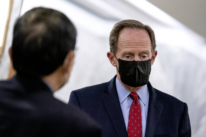 Senator Pat Toomey, a Republican from Pennsylvania, speaks to a member of the media while exiting the Senate Republican policy luncheon at the Hart Senate Office building in Washington, D.C., U.S., on Thursday, Nov. 12, 2020. Senate Republicans this week released 12 bills to fund the government through next September, the first move toward negotiations with House Democrats that will be vital to avoiding a federal shutdown next month. Photographer: Stefani Reynolds/Bloomberg