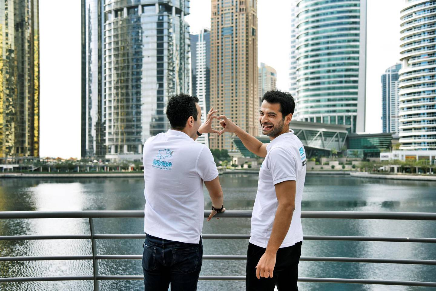 Kerem Kuyucu, right, and AliCagatay Ozcan, founders of Justmop, laugh while posing for photos outside their office at Jumeirah Lake Towers, Dubai, UAE, Wednesday, Feb. 12, 2020. The two have now transformed their marketplace into a super app and expanded into 4 GCC countries. Photos by Shruti Jain The National