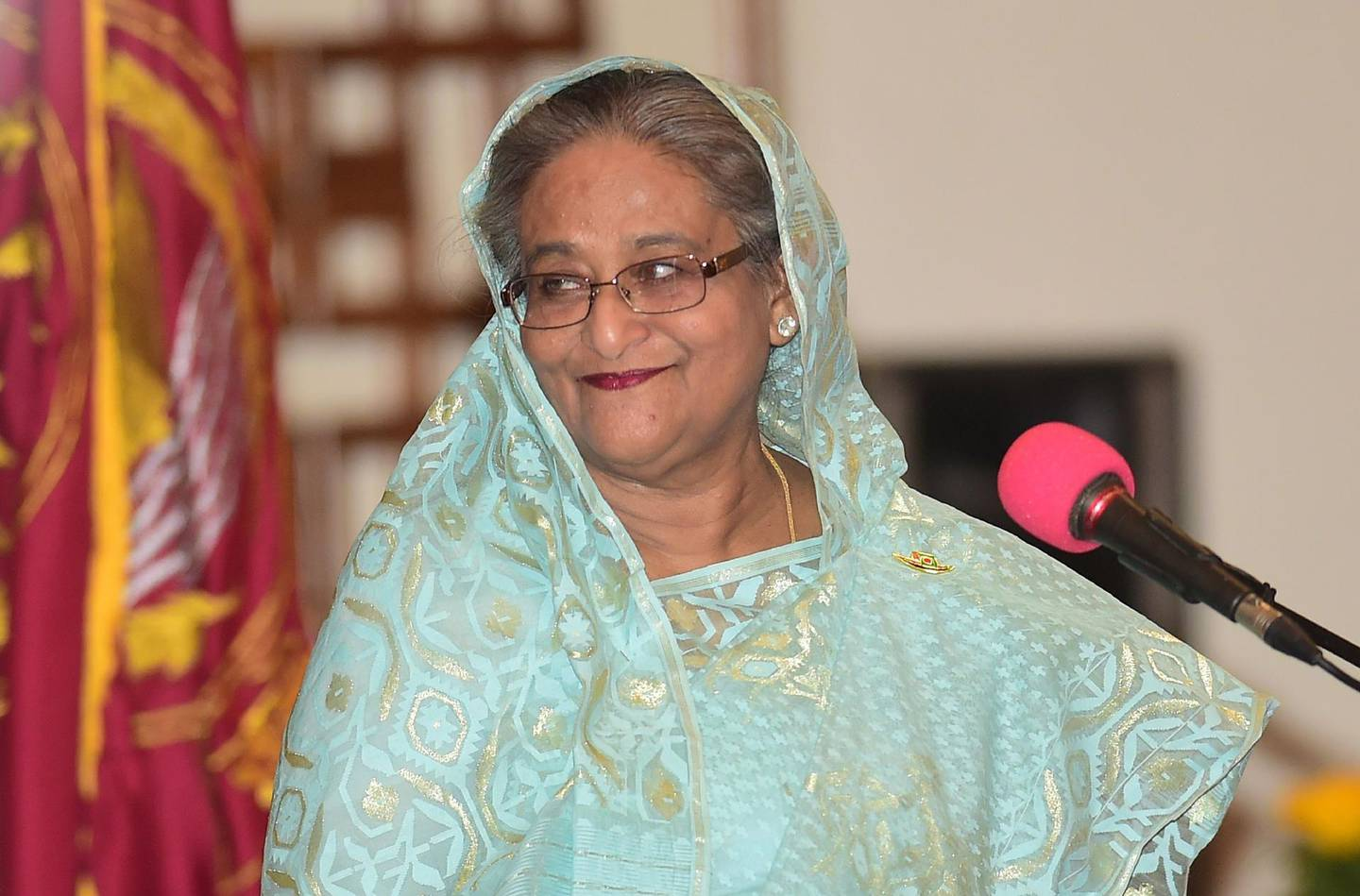 Sheikh Hasina smiles as she is sworn in for her fourth spell as Bangladesh's prime minister at the Presidential Palace in Dhaka on January 7, 2019. Sheikh Hasina was sworn in as Bangladesh's prime minister for a record fourth term January 7 after a crushing election victory marred by deadly violence and claims of widespread rigging.  / AFP / Munir UZ ZAMAN