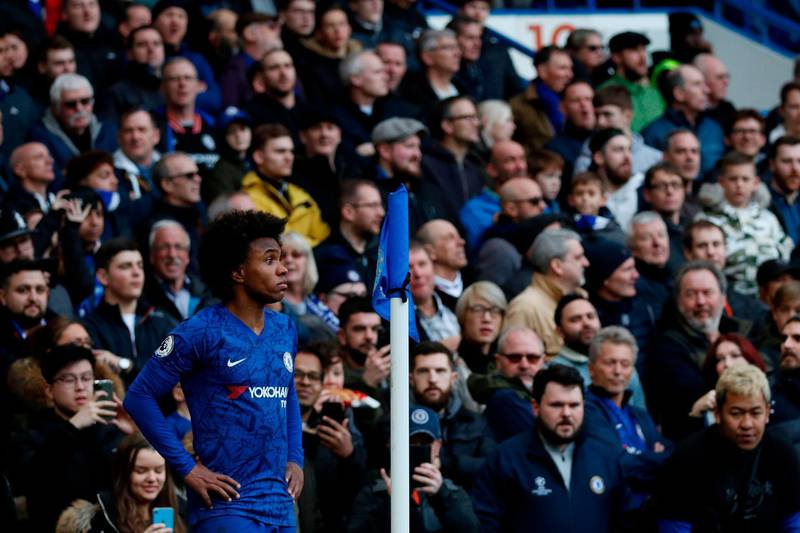 Chelsea's Brazilian midfielder Willian waits to take a corner kick during the English Premier League football match between Chelsea and Everton at Stamford Bridge in London on March 8, 2020. RESTRICTED TO EDITORIAL USE. No use with unauthorized audio, video, data, fixture lists, club/league logos or 'live' services. Online in-match use limited to 120 images. An additional 40 images may be used in extra time. No video emulation. Social media in-match use limited to 120 images. An additional 40 images may be used in extra time. No use in betting publications, games or single club/league/player publications.  / AFP / Adrian DENNIS / RESTRICTED TO EDITORIAL USE. No use with unauthorized audio, video, data, fixture lists, club/league logos or 'live' services. Online in-match use limited to 120 images. An additional 40 images may be used in extra time. No video emulation. Social media in-match use limited to 120 images. An additional 40 images may be used in extra time. No use in betting publications, games or single club/league/player publications.