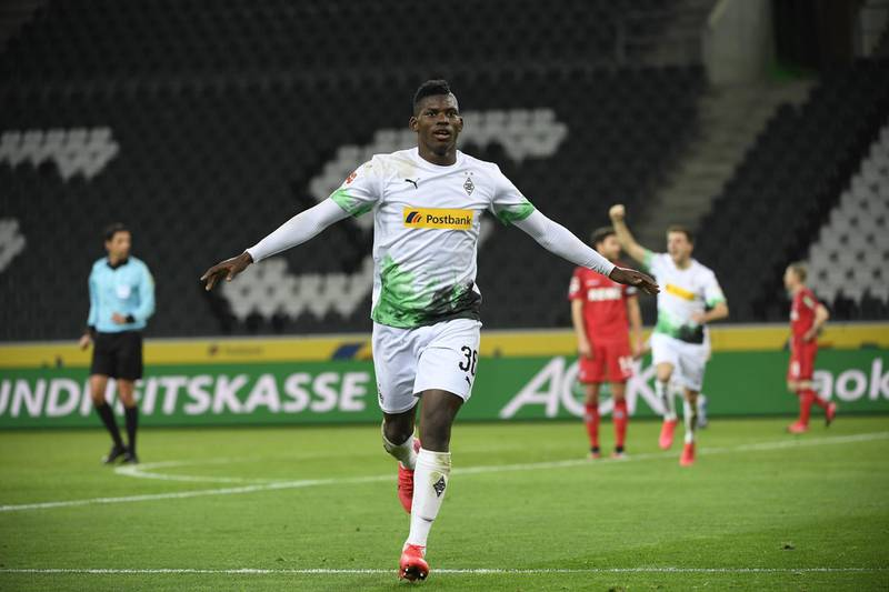 Moenchengladbach's Swiss forward Breel Embolo celebrates scoring the opening goal during the German first division Bundesliga football match Borussia Moenchengladbach v 1 FC Cologne in Moenchengladbach, western Germany on March 11, 2020. - Rhine Bundesliga derby between Borussia Moenchengladbach and Cologne, will be held behind closed doors due to the coronavirus, the first game in Bundesliga history to be played without fans. (Photo by Ina FASSBENDER / AFP) / DFL REGULATIONS PROHIBIT ANY USE OF PHOTOGRAPHS AS IMAGE SEQUENCES AND/OR QUASI-VIDEO
