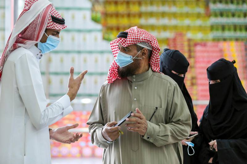 A man displays his details on his mobile phone using the Tawakkalna app, which was launched by Saudi authorities to track people infected with the coronavirus disease (COVID-19), as he enters the Al-Othaim market in Riyadh, Saudi Arabia February 22, 2021. Picture taken February 22, 2021. REUTERS/Ahmed Yosri