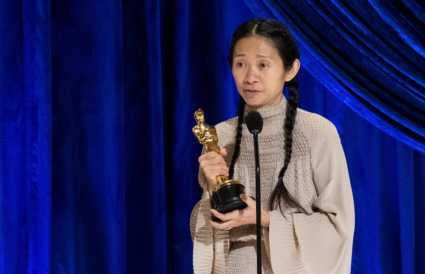 Chloe Zhao accepts the Oscar for Directing during the live ABC Telecast of The 93rd Oscars in Los Angeles, California, U.S., April 25, 2021. Todd Wawrychuk/A.M.P.A.S./Handout via REUTERS ATTENTION EDITORS. THIS IMAGE HAS BEEN SUPPLIED BY A THIRD PARTY. NO MARKETING OR ADVERTISING IS PERMITTED WITHOUT THE PRIOR CONSENT OF A.M.P.A.S AND MUST BE DISTRIBUTED AS SUCH. MANDATORY CREDIT. NO RESALES. NO ARCHIVES     TPX IMAGES OF THE DAY