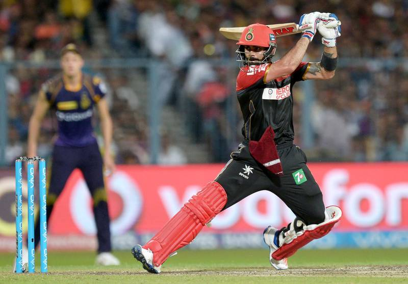 Royal Challengers Bangalore captain Virat Kohli plays a shot during the 2016 Indian Premier League (IPL) Twenty20 (T20) cricket match between Kolkata Knight Riders and Royal Challengers Bangalore at the Eden Gardens Cricket Stadium in Kolkata on May 16, 2016.  ----IMAGE RESTRICTED TO EDITORIAL USE - STRICTLY NO COMMERCIAL USE----- / GETTYOUT (Photo by Dibyangshu SARKAR / AFP)