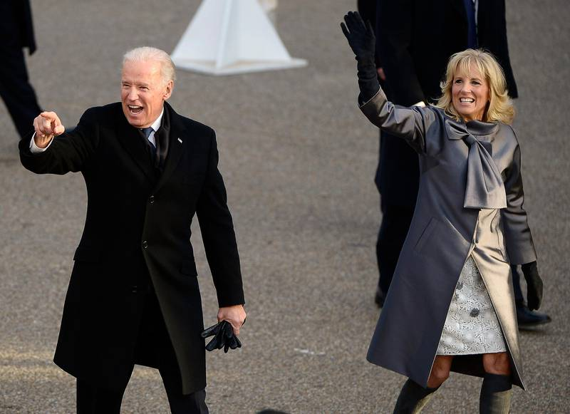 epa03548796 US Vice President Joe Biden (L) and his wife Dr Jill Biden (R) wave as they walk down Pennsylvania Avenue during the Inaugural parade after Biden was sworn in for a second term as the Vice President of the United States in Washington, DC, USA, 21 January 2013. Obama defeated Republican candidate Mitt Romney on Election Day 06 November 2012 to be re-elected for a second term.  EPA/TANNEN MAURY
