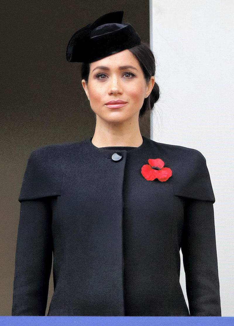 LONDON, UNITED KINGDOM - NOVEMBER 11: (EMBARGOED FOR PUBLICATION IN UK NEWSPAPERS UNTIL 24 HOURS AFTER CREATE DATE AND TIME) Meghan, Duchess of Sussex attends the annual Remembrance Sunday Service at The Cenotaph on November 11, 2018 in London, England. The armistice ending the First World War between the Allies and Germany was signed at Compiègne, France on eleventh hour of the eleventh day of the eleventh month - 11am on the 11th November 1918. This day is commemorated as Remembrance Day with special attention being paid for this year's centenary. (Photo by Max Mumby/Indigo/Getty Images)