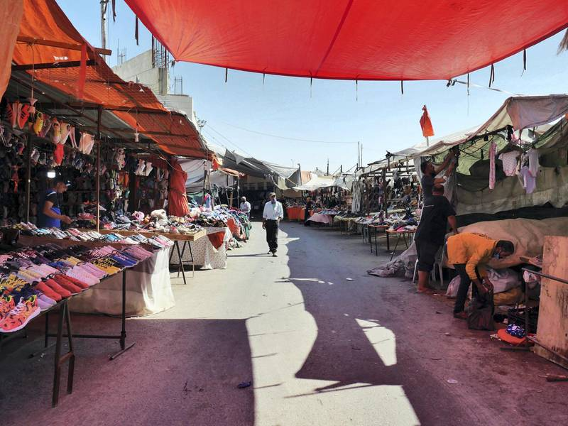 Pictured: The street within a market in Zarqa in which the victim ran a stall before his father was sent to prison for killing a man and the family was forced to leave the area.  19/10/2020 Photographer: Charlie Faulkner