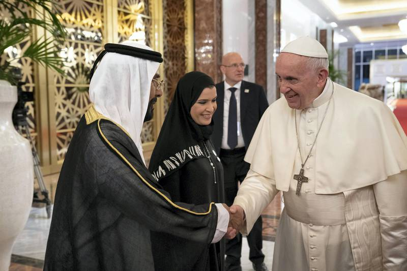 ABU DHABI, UNITED ARAB EMIRATES - February 3, 2019: Day one of the UAE Papal visit -HH Sheikh Tahnoon bin Mohamed Al Nahyan, Ruler's Representative in Al Ain Region (L) greets  His Holiness Pope Francis, Head of the Catholic Church (R) , at the Presidential Airport.  ( Ryan Carter / Ministry of Presidential Affairs ) ---