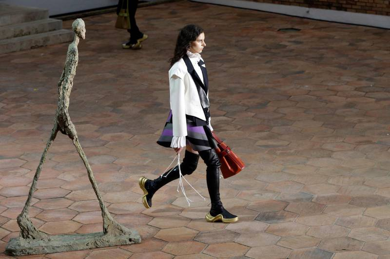 A model displays creations as part of the Louis Vuitton Cruise 2019 Collection presented at the Maeght Foundation in Saint Paul de Vence, southeastern France, Monday, May 28, 2018. (AP Photo/Claude Paris)
